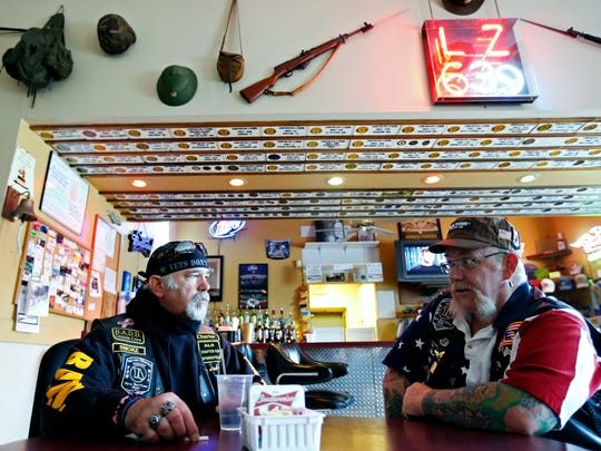 Rolling Thunder members and Vietnam War veterans David VanLieu (left) and Jason Lawrence wait at American Legion Post 639 in Springfield before Wednesday's ride to Point Lookout. The group rode to College of the Ozarks for the dedication of the new Vietnam War Veterans Memorial.