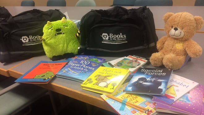 Six duffel bags filled with children's books and stuffed toys were donated to Golden House in Green Bay by the new Books to the Rescue! local chapter Jan. 19, 2017.