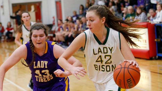 Benton Central's Kaylan Coffman drives the baseline against Brooke Treadway of Northwestern in the Girls 3A basketball sectional Friday, February 5, 2016, at West Lafayette High School. Benton Central defeated Northwestern 62-49.