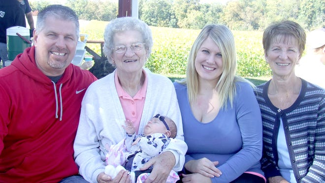From left to right,  Dale Good, Mildred Moyer holding her new great-great-granddaughter, Teigan Stehley, Erin Good, Joyce (Moyer) Good get together for a generation photo that was taken at the family farm in Ono.