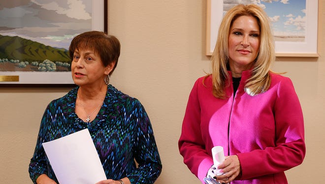 Patty Tiscareño, executive director of the Rio Grande Cancer Foundation, left, stands Monday with Susan G. Komen El Paso Board Chairwoman Kimberly René Vanecek after it was announced that Susan G. Komen El Paso will close in March. A new event — the Colors of Cancer Race, Our Colors Run Together — by the Rio Grande Cancer Foundation will take place April 2 at Cohen Stadium.