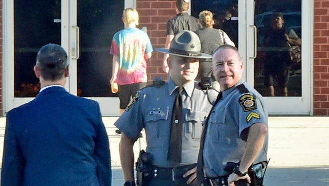 State Police are at the entrance to CASHS on Friday morning, September 15, 2017 afer alledged fights and threats and the school. School resource officers and Chambersburg Police were also at the school.