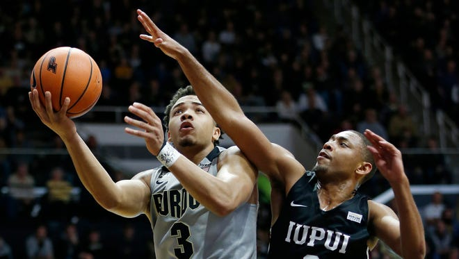 Carsen Edwards drives past Jaylen Minnett of IUPUI for a score Sunday, December 10, 2017, at Mackey Arena. Purdue defeated IUPUI 86-61.