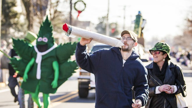 Hempy Leaf, the mascot of Delaware NORML, marches during a past Hummers Parade in Middletown. Delaware NORML will host a 4/20 pro-pot celebration Friday in Yorklyn.
