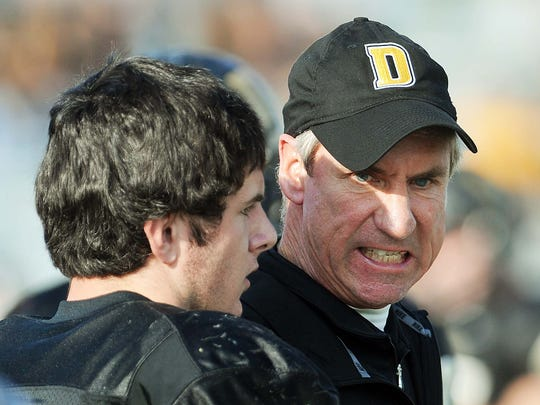 FILE – DePauw coach Bill Lynch has words with his QB Matt Hunt on the sidelines.