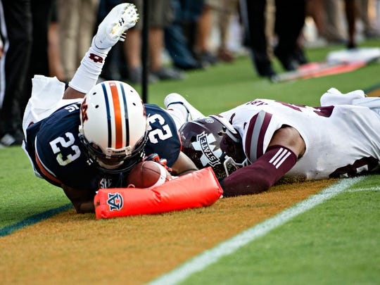 Auburn wide receiver Ryan Davis (23) dives for a touchdown during the NCAA football game between Auburn and Mississippi State on Saturday, Sept. 30, 2017 in Auburn, Ala.