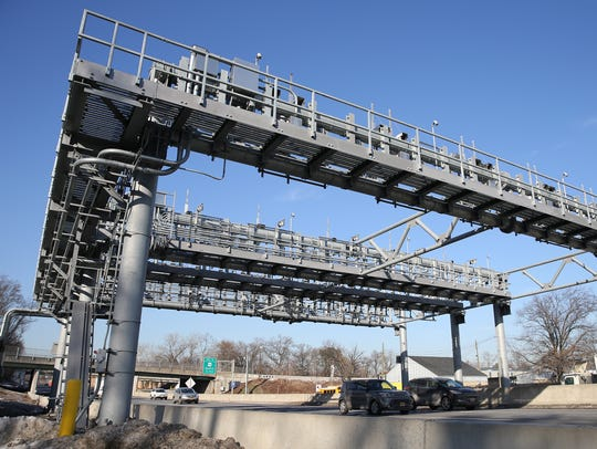 Cars pass under the cashless-toll gantry on the New