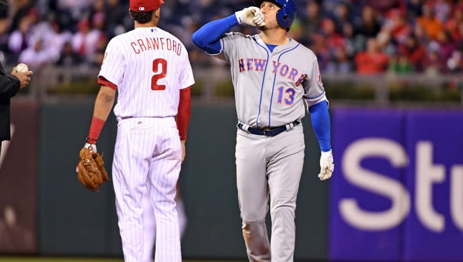 New York Mets shortstop Asdrubal Cabrera (13) reacts after hitting an RBI double during the seventh inning against the Philadelphia Phillies at Citizens Bank Park.