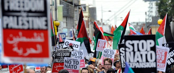 Demonstrators march during a protest attended by about 600 people ahead of the upcoming NATO Summit 2014, in Newport, Wales, Britain, on Aug. 30.
