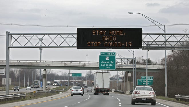 A digital sign on I-70 West towards downtown Columbus lets drive know to Stay Home, Ohio Stop Covid-19 on Tuesday afternoon on March 24, 2020 when Gov. Mike DeWine and then state health director Dr. Amy Acton imposed stay-at-home orders. Those orders have since been removed.