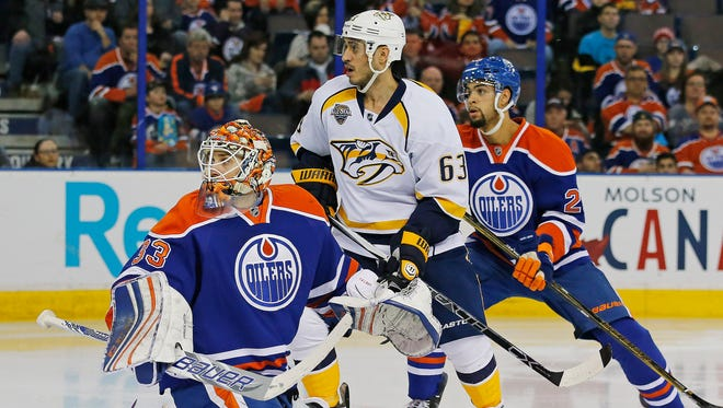 Nashville forward Mike Ribeiro (63) and Edmonton defenseman  Darnell Nurse (25) and goaltender Cam Talbot (33) look for the puck during the second period on Jan. 23, 2016.