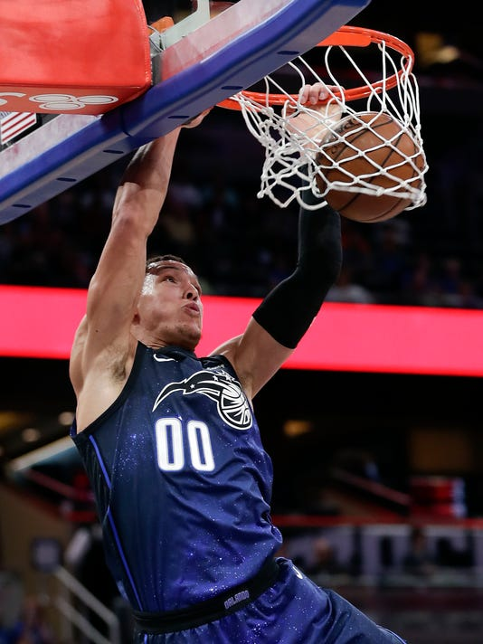 Orlando Magic's Aaron Gordon makes an uncontested dunk against the Phoenix Suns during the first half of an NBA basketball game Saturday, March 24, 2018, in Orlando, Fla. (AP Photo/John Raoux)
