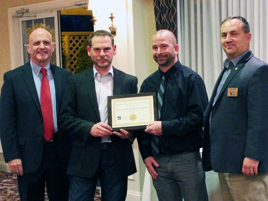 The  Hanover Area Chamber of Commerce award for Small Business of the Year went to Miscreation. Pictured are, from left, Gary Laird, Hanover Chamber; Mark Mathias and Brent Stambaugh, Miscreation Brewing Company and Kevin Gulden, Utz Quality Foods.