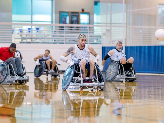 The QuadCrushers wheelchair rugby based at MTSU practice recently inside the Campus Recreation Center. Shown, from left, are players Shakir Perry, an MTSU leisure, sport and tourism studies major, team coach and Paralympic gold medalist Eddie Crouch, Justin Jordan and David Jordan.