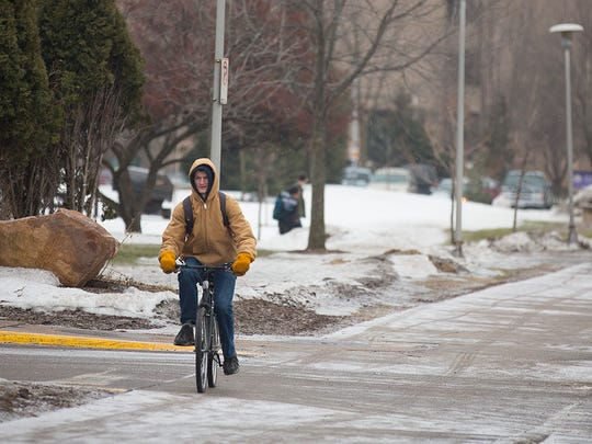 Junior Mike Polanski, 20, rides his bike along Isadore Street on the University of Wisconsin-Stevens Point campus, Monday, Feb. 22, 2016.
