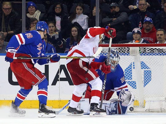 Red Wings defenseman Trevor Daley (83) scores the game winning goal against Rangers goalie Henrik Lundqvist (30) during the overtime period of the Wings' 3-2 win over the Rangers on Sunday, Feb. 25, 2018, in New York.