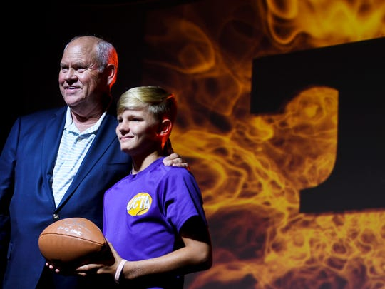 Gavin Moran has his photo taken with current University of Tennessee Vols Athletic Director Phillip Fulmer, Thursday, July 26 at Second Baptist Church of Union City during a Night of Orange and White.