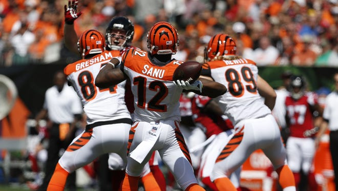 Cincinnati Bengals wide receiver Mohamed Sanu (12) throws the ball on a fake for a first down.