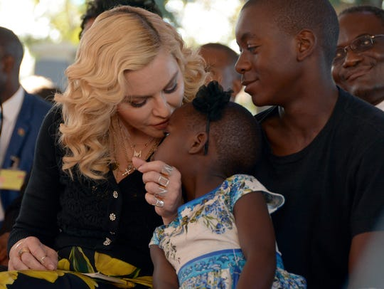 Madonna is seen with two of her adopted kids from Malawi,