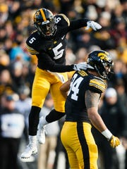 Manny Rugamba (5) leaped to celebrate an A.J. Epenesa sack in this 2017 Iowa football game vs. Purdue. Now playing for the Miami of Ohio Redhawks, Rugamba will return to Kinnick Stadium to square off with his former teammates Saturday.;