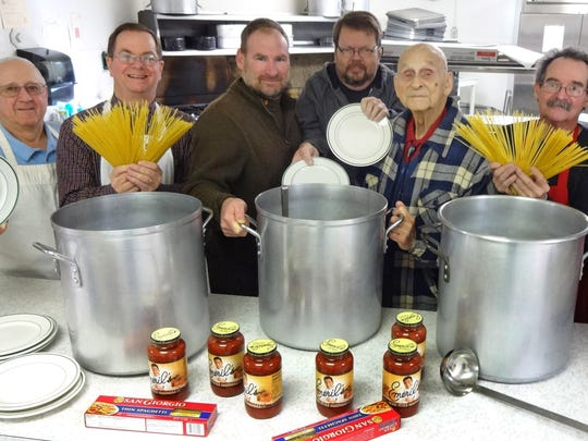 Delbert Maurice Davis, with plaid jacket, is joined by members of Scout Troop No. 149 in celebrating the 50th anniversary of the troop's annual spaghetti dinner. Davis and his assistant, Harold Bawman, started the tradition 50 years ago to benefit the troop. From left are Carl Gilbert, Sam Doughty, current Scoutmaster Mike Bievenour, Mark Winebrenner, Davis, Robert Parker and Mike Blaher.