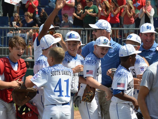 Sioux Falls players and coaches celebrate after the