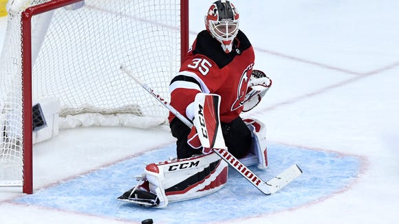New Jersey Devils goaltender Cory Schneider (35) makes a save in the second period. The Devils defeat the Lightning 5-2 in Game 3 of Round 1 of the Stanley Cup Playoffs at the Prudential Center in Newark, NJ on Monday, April 16, 2018. The series is 2-1, Tampa Bay.