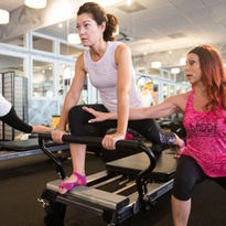 Meet Me at the Gym: Feel the burn on Pilates reformer beds at studio in North Naples