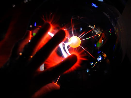 Colorful light in a plasma ball in one of the newer activity areas at the Impression 5 Science Center.