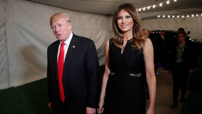 President Donald Trump and first lady Melania arrive for Christmas Eve service at the Church of Bethesda-by-the-Sea in West Palm Beach, Fla.,