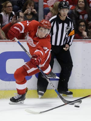 Red Wings center Dylan Larkin shoots during the second period.