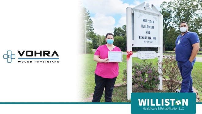 Christina Crain (left), director of nursing at Williston Healthcare & Rehabilitation, and Dr. Jean-Paul Wuilleumier (right), wound doctor, proudly display the facility's certification as a Center of Excellence for Wound Management.