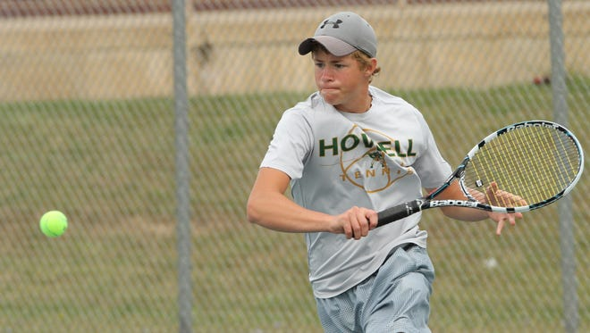 Howell's Mike Zehnder zeroes in on the ball in his No. 1 singles match against Pinckney's Nicholas Marlatt Thursday at Fowlerville.