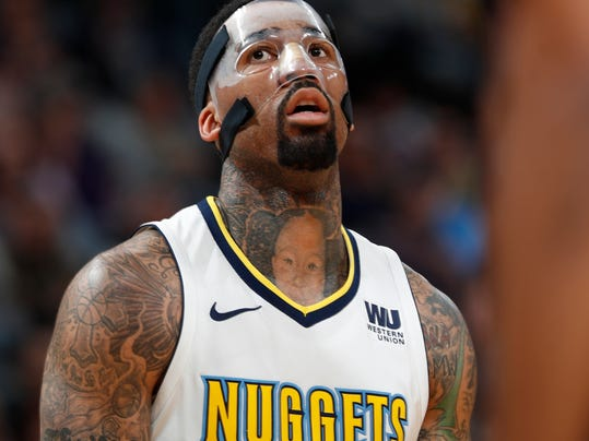 Denver Nuggets forward Wilson Chandler wears a mask to protect his broken nose while facing the Indiana Pacers in the first half of an NBA basketball game Tuesday, April 3, 2018, in Denver. (AP Photo/David Zalubowski)