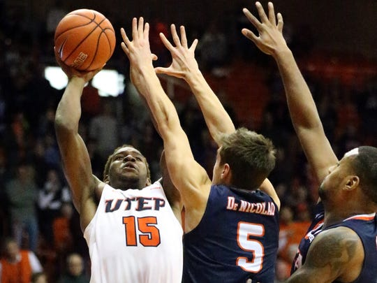 UTEP's Dominic Artis, 15, rises to get the ball over