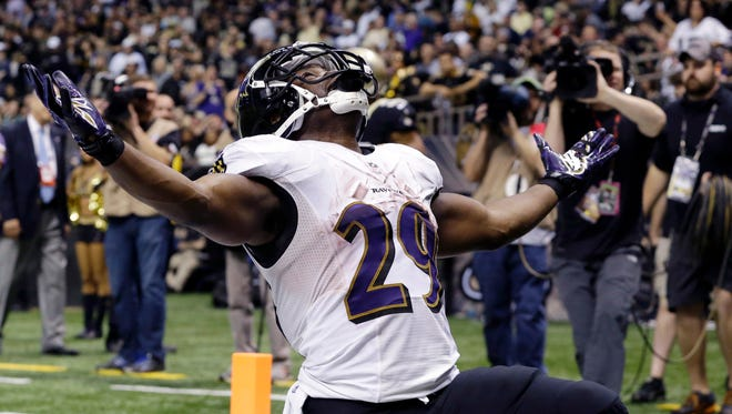 Baltimore Ravens running back Justin Forsett celebrates after scoring his second touchdown during the Ravens' 34-27 win over the New Orleans Saints at the Mercedes-Benz Superdome Monday night.