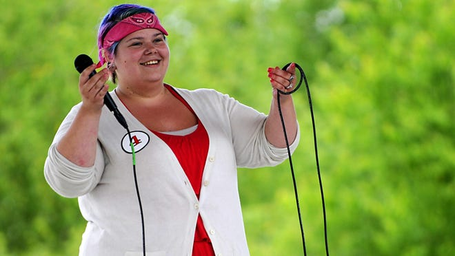 Alexandra Lesniak asks the crowd to sing along with her during her set at Granite City Days karaoke contest Saturday at Lake George.