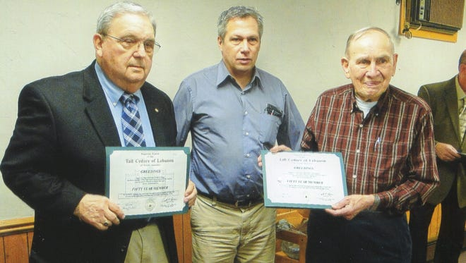 Barry Heap, left, and Paul Harnish, right, of the Tall Cedars of Lebanon Quittapahilla Forest No. 25, jhold 50-year awards they received recently. With them is Rick Snyder, Supreme Tall Cedar of District 11, which includes Lebanon County.