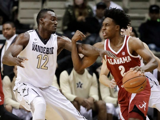 Vanderbilt center Djery Baptiste (12) defends against Alabama guard Collin Sexton (2) in the first half of an NCAA college basketball game Tuesday, Jan. 2, 2018, in Nashville, Tenn. (AP Photo/Mark Humphrey)
