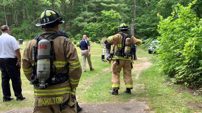 Firefighters take a cautious approach organizing a hazardous materials response after a chemical agent was thought to be in a car in Oak Hill Cemetery on Tuesday.