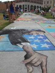 One of the drawings depicts Rev. Martin Luther King Jr. at ChalkFest in downtown Wausau, Sunday, July, 10, 2011. Dan Young/Wausau Daily Herald.