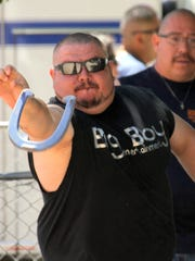 Local horseshoe pitcher Lonnie Almanza took aim at the stake during the Great American Horseshoe Tournament Saturday at McKinley Duck Downs.