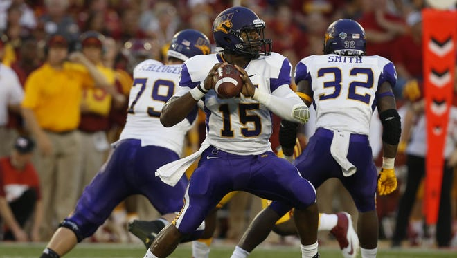 Northern Iowa quarterback Aaron Bailey (15) looks down field over Iowa State for a receiver Saturday, Sept. 5, 2015, at Jack Trice Stadium in Ames.