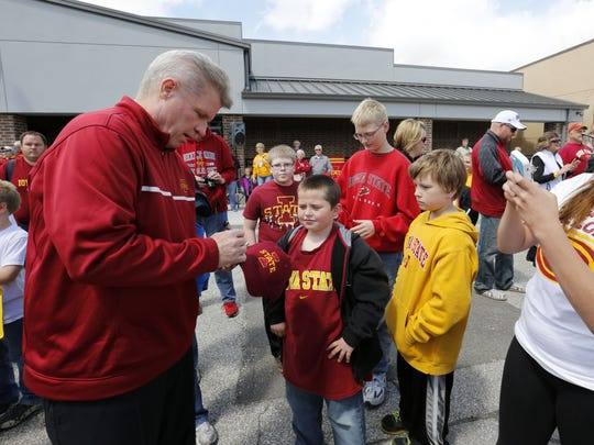 Iowa State women's basketball coach Bill Fennelly signs autographs for fans during the first stop of the 2014 Cyclone Tailgate Tour.