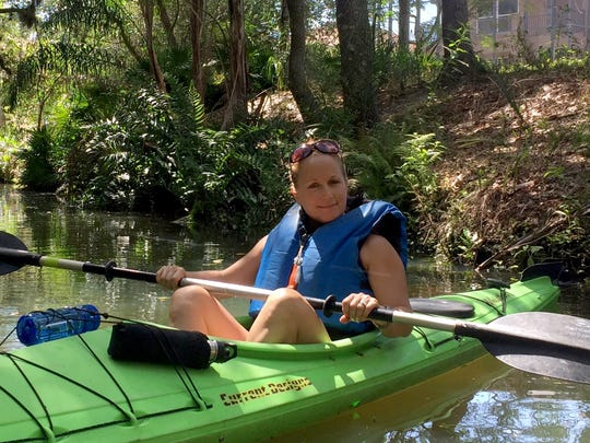 Dr. Teresa Sievers kayaks the Estero River in May 2015.