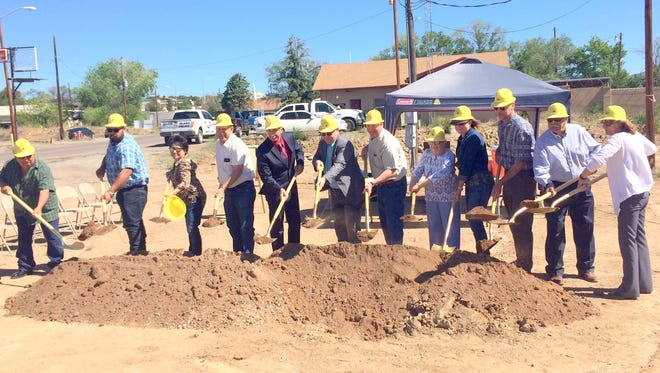 Village of Santa Clara Mayor Richard Bauch leads the Board of Trustees along with others in a groundbreaking ceremony for a Splash Park.