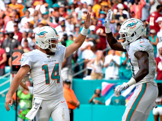 Dolphins quarterback Ryan Fitzpatrick and receiver DeVante Parker.