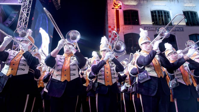 The Tennessee marching band performs during the battle of the bands, part of Franklin American Mortgage Music City Bowl activities on Broadway on Thursday, Dec. 29, 2016.