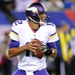 Oct 21, 2013; East Rutherford, NJ, USA; Minnesota Vikings quarterback Josh Freeman (12) drops back to pass against the New York Giants during the first half at MetLife Stadium.
