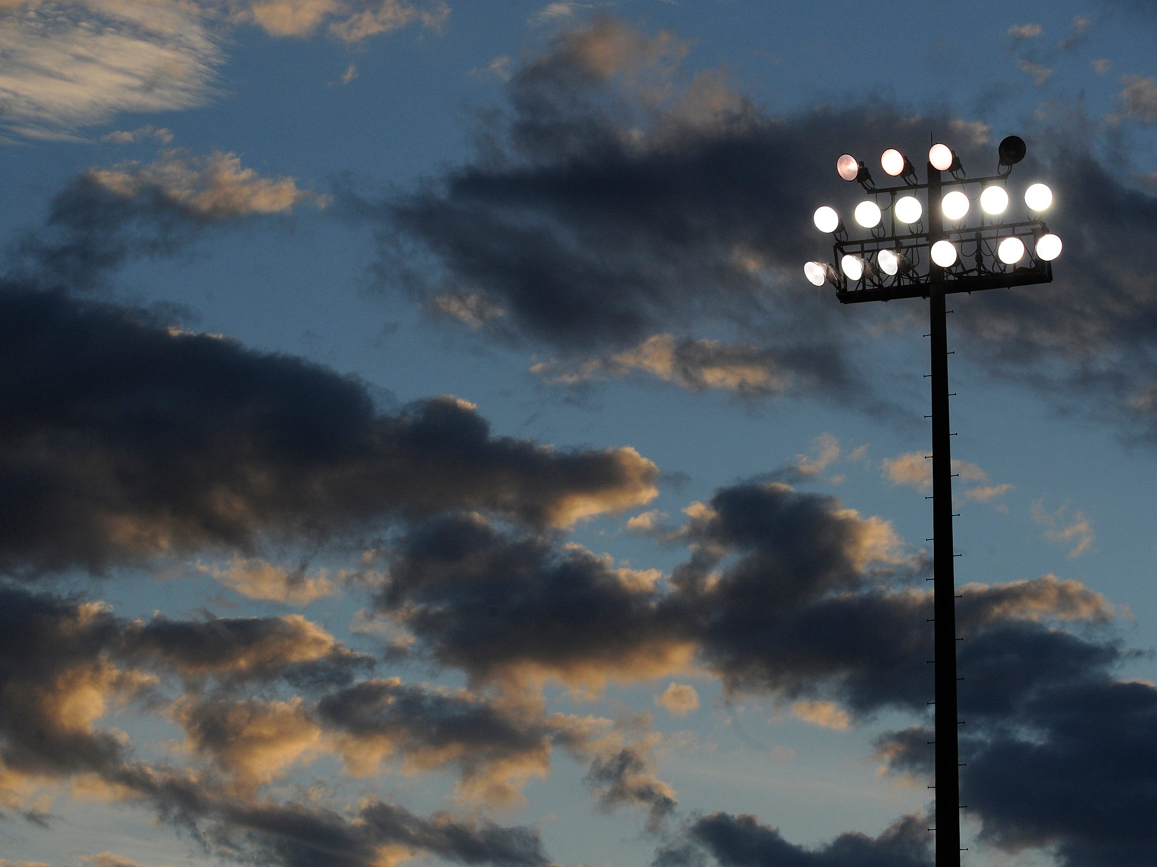 The sun sets before Park Crossing plays St. James on Friday September 26, 2014 at the St. James campus in Montgomery, Ala.